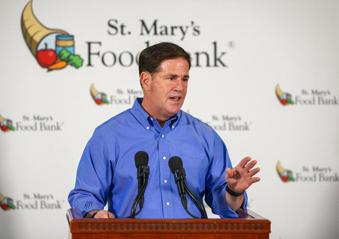 Arizona Gov. Doug Ducey holds a COVID-19 briefing at St. Mary's Food Bank in Phoenix, Thursday, Oct. 29, 2020. (Rob Schumacher/The Arizona Republic via AP)