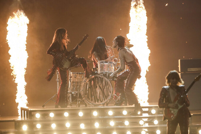Maneskin from Italy performs Zitti E Buoni at the Grand Final of the Eurovision Song Contest at Ahoy arena in Rotterdam, Netherlands, Saturday, May 22, 2021. (AP Photo/Peter Dejong)
