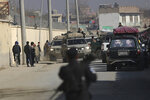 Afghan security forces' vehicles are seen at the site of a shootout in Kabul, Afghanistan, Monday, Dec. 2, 2019. An Afghan official says a gunman has opened fire on a vehicle in the capital, Kabul. (AP Photo/Altaf Qadri)