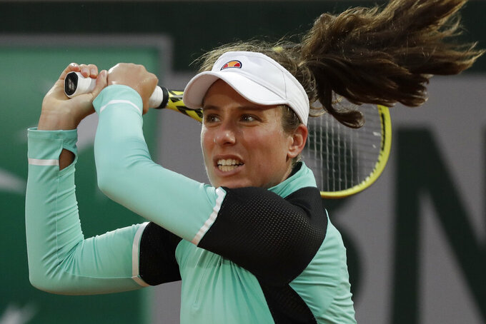 """FILE - Britain's Johanna Konta plays a shot against Cori Gauff in the first round match of the French Open tennis tournament at Roland Garros stadium in Paris, France, in this Sunday, Sept. 27, 2020, file photo. Three-time Grand Slam semifinalist Johanna Konta returned to competition Tuesday, Aug. 10, 2021, after a two-month absence during which she caught COVID-19 and dealt with what she called """"a massive range of symptoms."""" """"Definitely the worst illness I've experienced for a very long time,"""" Konta said in an interview with The Associated Press.(AP Photo/Alessandra Tarantino, File)"""