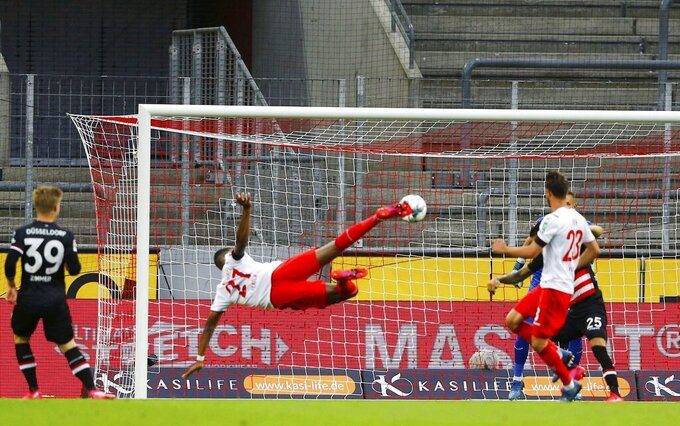 FC Cologne's Anthony Modeste shoots at goal during a German Bundesliga soccer match between 1. FC Cologne and Fortuna Duesseldorf in Cologne, Germany, Sunday, May 24, 2020.  (Thilo Schmuelgen/pool via AP)