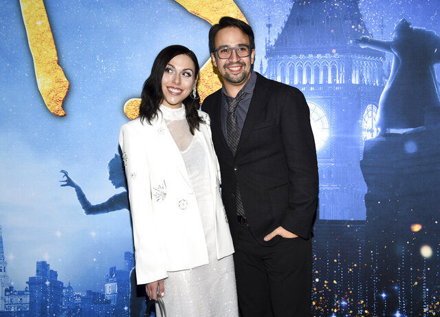 Actor Lin-Manuel Miranda, right, and wife Vanessa Nadal attend the world premiere of