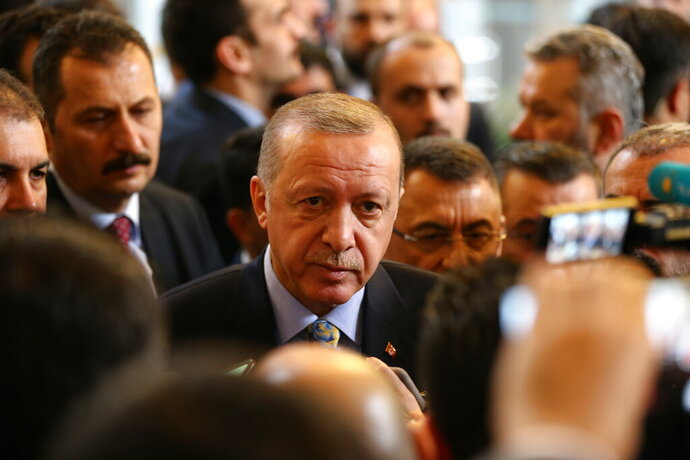 Turkey's President Recep Tayyip Erdogan leaves after delivering a speech to MPs of his ruling Justice and Development Party (AKP) at the parliament in Ankara, Turkey, Tuesday, Jan. 15, 2019. (AP Photo/Burhan Ozbilici)