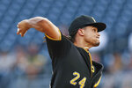 Pittsburgh Pirates starter Chris Archer pitches against the Washington Nationals in the first inning of a baseball game, Tuesday, Aug. 20, 2019, in Pittsburgh. Archer left the field with a trainer before starting the second inning.(AP Photo/Keith Srakocic)