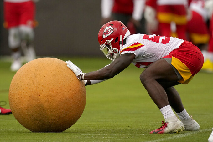 Kansas City Chiefs linebacker Willie Gay Jr. participates in a drill during the NFL football team's organized team activities Thursday, May 27, 2021, in Kansas City, Mo. (AP Photo/Charlie Riedel)