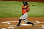 Houston Astros Jose Altuve watches a ball hit for a home run in the first inning of a baseball game against the Texas Rangers in Arlington, Texas, Sunday, Sept. 27, 2020. (AP Photo/Roger Steinman)