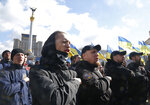 Far-right demonstrators gesture during a rally against corruption in downtown Kiev, Ukraine, Saturday, March 23, 2019. (AP Photo/Efrem Lukatsky)
