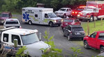 Emergency personnel respond to the scene where a group tubing on the Dan river went over a dam on Thursday, June 17, 2021, near Eden, N.C. Local officials in North Carolina say the body of a fourth tuber has been found in a river following a deadly accident in which a family on a recreational float went over a dam. One tuber now remains missing Sunday, June 21, following Wednesday night's accident that involved nine people. (WSET-TV via AP)