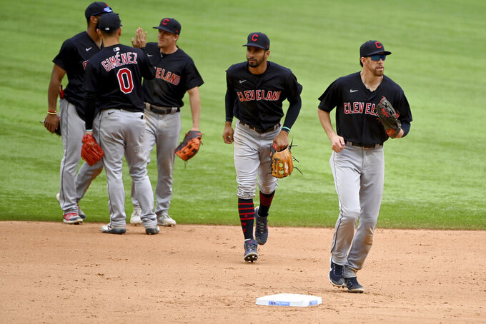Cleveland Indians players, led by Bradley Zimmer, right, leave the field after their win over the Texas Rangers in a baseball game in Arlington Texas, Sunday, Oct. 3, 2021. (AP Photo/Matt Strasen)