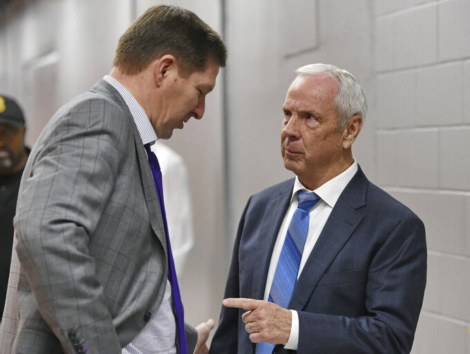 North Carolina coach Roy Williams, right, speaks with Clemson coach Brad Brownell after an NCAA college basketball game Saturday, March 2, 2019, in Clemson, S.C. North Carolina won 81-79. (AP Photo/Richard Shiro)