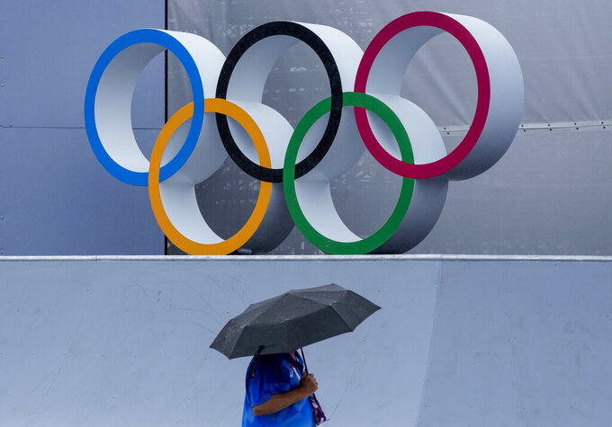 A venue official takes a look at the BMX Freestyle course after a training session was cancelled due to rain, at the 2020 Summer Olympics, Tuesday, July 27, 2021, in Tokyo, Japan. (AP Photo/Ben Curtis)
