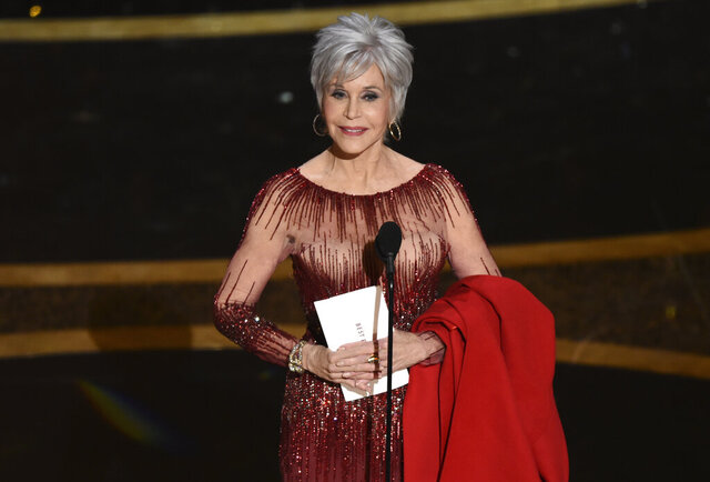 FILE - In this Feb. 9, 2020 file photo, Jane Fonda presents the award for best picture at the Oscars at the Dolby Theatre in Los Angeles. Fonda is among the speakers tapped to mark the 50th anniversary of the Kent State shootings.  The 82-year-old actress and activist will highlight four days of events the Ohio university has planned to explore the lasting impacts of the events of May 4, 1970, which were considered pivotal in turning public sentiment against the Vietnam War. (AP Photo/Chris Pizzello, File)