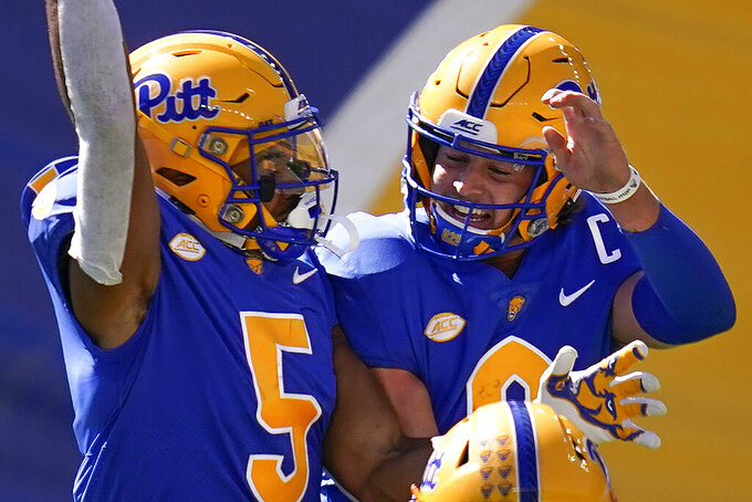 Pittsburgh wide receiver Jared Wayne (5) celebrates with quarterback Kenny Pickett (8) after catching a touchdown pass from him during the second half of an NCAA college football game against Syracuse, Saturday, Sept. 19, 2020, in Pittsburgh. (AP Photo/Keith Srakocic)