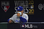 Los Angeles Dodgers manager Dave Roberts watches during the sixth inning in Game 5 of the baseball World Series against the Tampa Bay Rays Sunday, Oct. 25, 2020, in Arlington, Texas. (AP Photo/Tony Gutierrez)