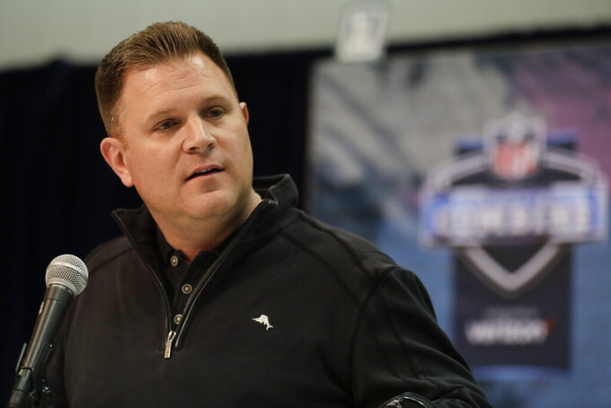 FILE - In this Feb. 27, 2019, file photo, Green Bay Packers general manager Brian Gutekunst speaks during a press conference at the NFL football scouting combine in Indianapolis. The potential challenges inherent in the NFL draft's virtual format became apparent Monday, April 20, 2020, as  Gutekunst conducted a conference call with reporters. Gutekunst was about to answer a question when a technical issue caused him to get dropped from the call for about a minute. (AP Photo/Michael Conroy, File)