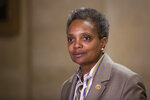 Chicago Mayor-elect Lori Lightfoot speaks to reporters after meeting with Mayor Rahm Emanuel at City Hall, Wednesday, April 3, 2019, the day after she defeated Toni Preckwinkle in a runoff election. (Ashlee Rezin/Chicago Sun-Times via AP)