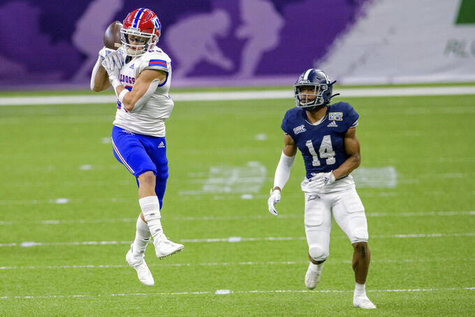 Louisiana Tech wide receiver Griffin Hebert (80) can't grab a catch against Georgia Southern cornerback Darrell Baker Jr. (14) during the first half of the New Orleans Bowl NCAA college football game in New Orleans, Wednesday, Dec. 23, 2020. (AP Photo/Matthew Hinton)