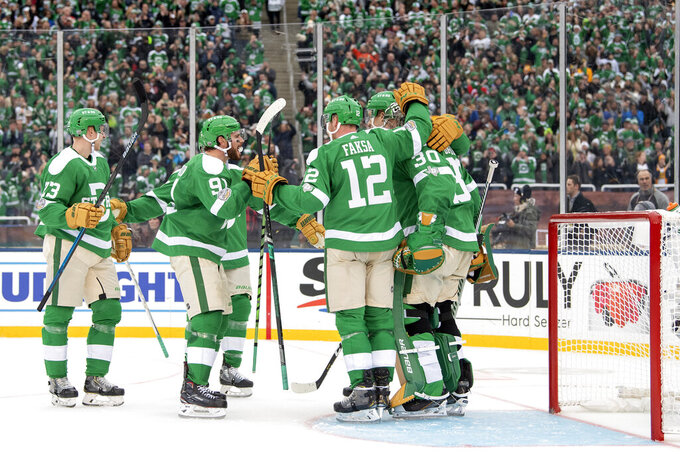 The Dallas Stars celebrate their 4-2 win over the Nashville Predators at the end of the NHL Winter Classic hockey game at the Cotton Bowl, Wednesday, Jan. 1, 2020, in Dallas. (AP Photo/Jeffrey McWhorter)