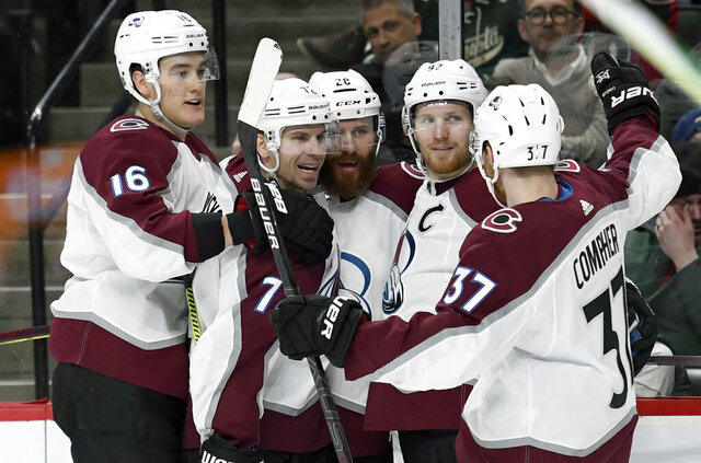 Colorado Avalanche' Nikita Zadorov (16), of Russia, Joonas Donskoi (72), of Finland, Ian Cole (28), Gabriel Landeskog (92), of Sweden, and J.T. Compher (37) celebrate a by Landeskog against the Minnesota Wild during the second period of an NHL hockey game Sunday, Feb. 9, 2020, in St. Paul, Minn. (AP Photo/Hannah Foslien)
