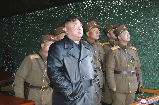 In this photo provided by the North Korean government, North Korean leader Kim Jong Un inspects military exercise at an undisclosed location in North Korea on Saturday, March 21, 2020. Independent journalists were not given access to cover the event depicted in this image distributed by the North Korean government. The content of this image is as provided and cannot be independently verified. Korean language watermark on image as provided by source reads: