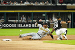 Pittsburgh Pirates' Ben Gamel (18) steals second on a throw from Chicago White Sox catcher Yasmani Grandal to Leury Garcia during the first inning of a baseball game Tuesday, Aug. 31, 2021, in Chicago. Gamel advanced to third on Grandal's throwing error. (AP Photo/Charles Rex Arbogast)