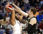 Vanderbilt's Matt Ryan, right, defends against Texas A&M forward Josh Nebo in the second half of an NCAA college basketball game at the Southeastern Conference tournament, Wednesday, March 13, 2019, in Nashville, Tenn. Texas A&M won 69-52. (AP Photo/Mark Humphrey)
