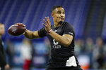 Oklahoma quarterback Jalen Hurts runs a drill at the NFL football scouting combine in Indianapolis, Thursday, Feb. 27, 2020. (AP Photo/Michael Conroy)