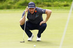 Justin Rose measures his putt on the 18th hole during the third round of the Zozo Championship golf tournament Saturday, Oct. 24, 2020, in Thousand Oaks, Calif. (AP Photo/Marcio Jose Sanchez)