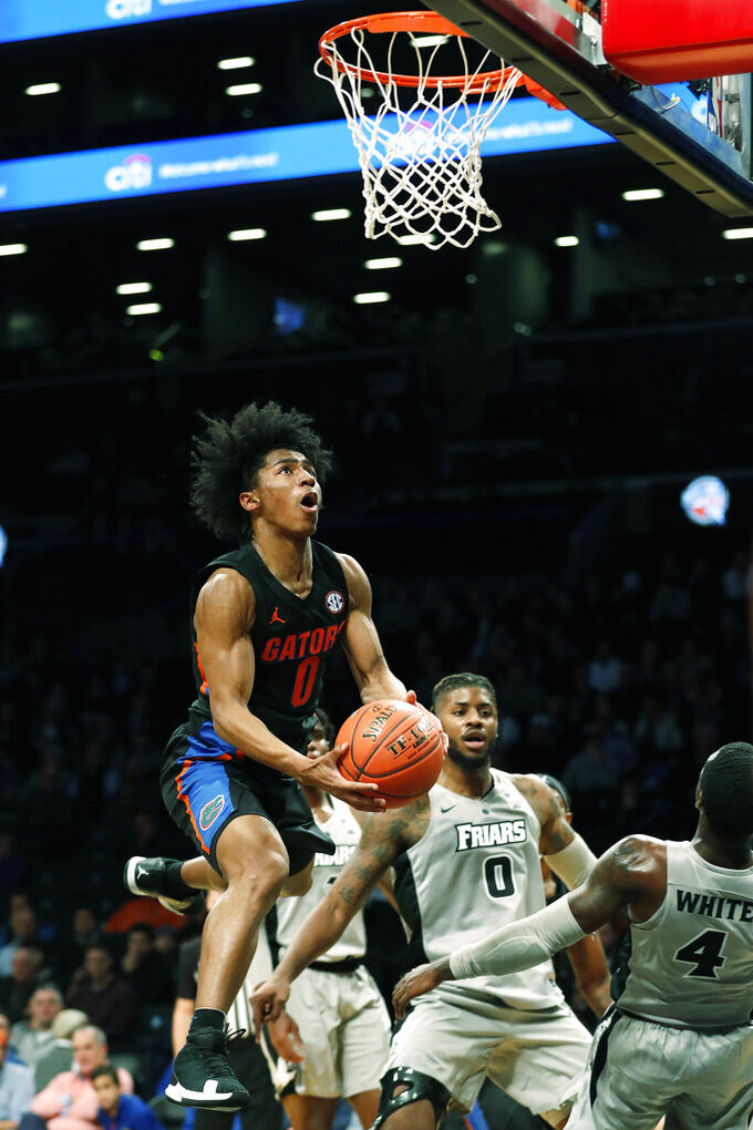 Florida guard Ques Glover (0) scores on a layup against Providence during the first half of an NCAA college basketball game at Barclays Center, Tuesday, Dec. 17, 2019, in New York. (AP Photo/Michael Owens)