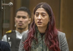 Sara Qasem gives her victim impact statement during the sentencing hearing for Australian Brenton Harrison Tarrant at the Christchurch High Court after Tarrant pleaded guilty to 51 counts of murder, 40 counts of attempted murder and one count of terrorism in Christchurch, New Zealand, Wednesday, Aug. 26, 2020. More than 60 survivors and family members will confront the New Zealand mosque gunman this week when he appears in court to be sentenced for his crimes in the worst atrocity in the nation's modern history. (John Kirk-Anderson/Pool Photo via AP)