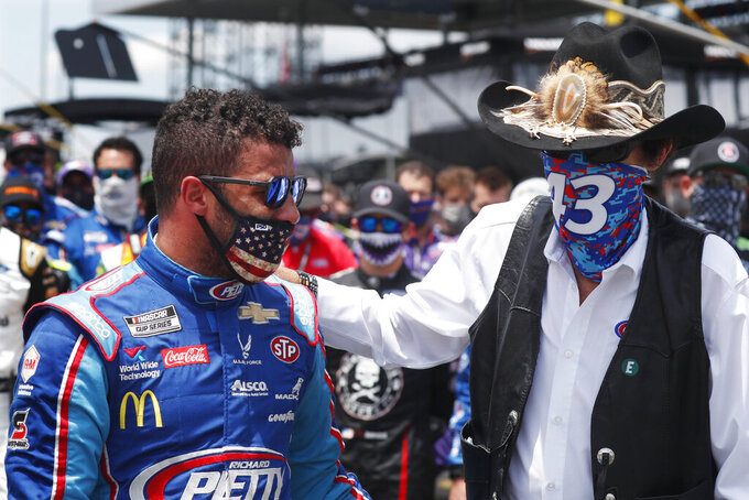 Team owner Richard Petty, right, consoles driver Bubba Wallace prior to the start of the NASCAR Cup Series at the Talladega Superspeedway in Talladega, Ala., on June 22, 2020. The day before, a noose was found in the Wallace's garage stall. (AP Photo/John Bazemore)