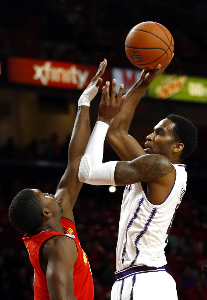Northwestern forward Vic Law, right, shoots over Maryland guard Darryl Morsell in the first half of an NCAA college basketball game, Tuesday, Jan. 29, 2019, in College Park, Md. (AP Photo/Patrick Semansky)