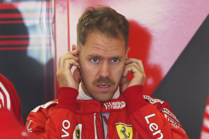 Ferrari driver Sebastian Vettel of Germany prepares for the first practice session of the Chinese Formula One Grand Prix at the Shanghai International Circuit in Shanghai on Friday, April 12, 2019. (AP Photo/Ng Han Guan)