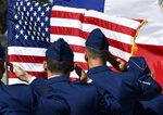 U.S. Air Force officers salute the flag during the singing of the National Anthem at the start of dedication of the Dyess Memorial Park expansion Friday, July 19, 2019 in Abilene, Texas.  The expanded park now recognizes the 79 military personnel who've given their lives since what originally was known as Abilene Air Force Base opened in 1956.  (Ronald W. Erdrich /The Abilene Reporter-News via AP)