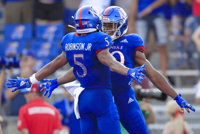 Kansas running back Khalil Herbert, right, celebrates his touchdown with teammate Stephon Robinson Jr. (5) during the first half of an NCAA college football game against Coastal Carolina in Lawrence, Kan., Saturday, Sept. 7, 2019. (AP Photo/Orlin Wagner)