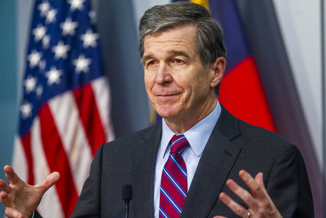 North Carolina Gov. Roy Cooper speaks during a briefing on North Carolina's coronavirus pandemic response Wednesday, Jan. 27, 2021 at the NC Emergency Operations Center in Raleigh, N.C. (Travis Long/The News & Observer via AP)