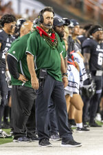 Hawaii head coach Nick Rolovich glances at the scoreboard during the first half of an NCAA college football game against Oregon State, Saturday, Sept. 7, 2019, in Honolulu. (AP Photo/Eugene Tanner)