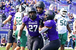 Northwestern running back Anthony Tyus III, left, celebrates with wide receiver Jacob Gill, right, and wide receiver Genson Hooper Price after he scored a touchdown during the second half of an NCAA college football game in Evanston, Ill., Saturday, Sept. 25, 2021. Northwestern won 35-6. (AP Photo/Nam Y. Huh)