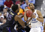 North Carolina's Garrison Brooks (15) looks to shoot against Washington's Noah Dickerson (15) in the second half during a second-round men's college basketball game in the NCAA Tournament in Columbus, Ohio, Sunday, March 24, 2019. (AP Photo/Tony Dejak)