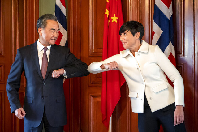 Chinese Foreign Minister Wang Yi, left, does a socially distanced greeting with Norwegian Foreign Minister Ine Eriksen Soreide during a short visit to Oslo, Thursday, Aug. 27, 2020. The visit is part of a round trip to several European countries. (Heiko Junge/NTB scanpix via AP)