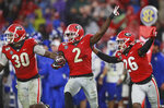 October 19, 2019 Athens: Georgia defensive back Richard LeCounte, center, celebrates recovering a Kentucky fumble with teammates Tae Crowder, left, and Tyrique McGhee during the second half of an NCAA college football game Saturday, Oct. 19, 2019, in Athens, Ga. (Curtis Compton/Atlanta Journal Constitution via AP)