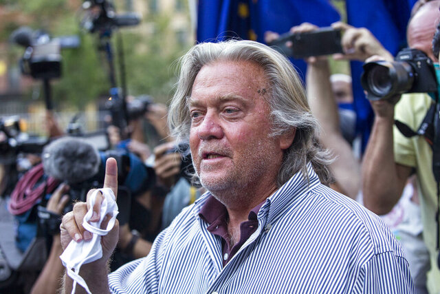 FILE - In this Aug. 20, 2020, file photo, President Donald Trump's former chief strategist, Steve Bannon, speaks with reporters in New York after pleading not guilty to charges that he ripped off donors to an online fundraising scheme to build a southern border wall. William A. Burck, a prominent Washington lawyer defending Bannon against the charges, notified a judge on Wednesday, Nov. 25, 2020, that he will no longer be representing Bannon in the case. (AP Photo/Eduardo Munoz Alvarez, File)