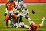 Denver Broncos cornerback Michael Ojemudia (23) forces a fumble by Las Vegas Raiders wide receiver Henry Ruggs III (11) during the second half of an NFL football game, Sunday, Jan. 3, 2021, in Denver. (AP Photo/Jack Dempsey)