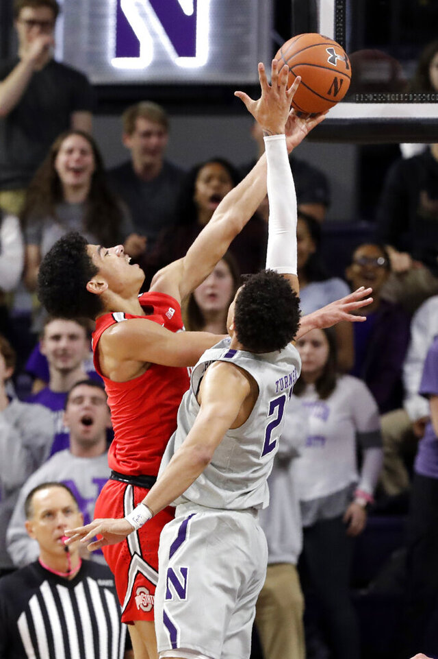 Ohio State guard D.J. Carton, front left, shoots against Northwestern forward A.J. Turner during the second half of an NCAA college basketball game in Evanston, Ill., Sunday, Jan. 26, 2020. (AP Photo/Nam Y. Huh)