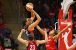 Las Vegas Aces center Liz Cambage (8) shoots above Washington Mystics forward Aerial Powers (23) and forward Tianna Hawkins, right, during the first half of Game 1 of a WNBA playoff basketball series Tuesday, Sept. 17, 2019, in Washington. (AP Photo/Nick Wass)