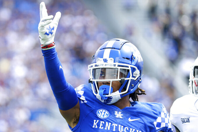 Kentucky wide receiver Wan'Dale Robinson (1) celebrates getting a first down during the first half of a NCAA college football game against Chattanooga in Lexington, Ky., Saturday, Sept. 18, 2021. (AP Photo/Michael Clubb)