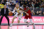 Northern Kentucky guard Tyler Sharpe (15) drives on Illinois-Chicago guard Marcus Ottey during the first half of an NCAA college basketball game for the Horizon League men's tournament championship in Indianapolis, Tuesday, March 10, 2020. (AP Photo/Michael Conroy)