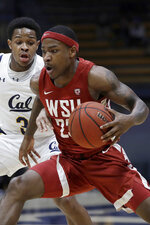 FILE - In this Jan. 9, 2020, file photo, Washington State's Jaylen Shead, right, moves the ball as California's Paris Austin defends during the first half of an NCAA college basketball game in Berkeley, Calif. Texas State ordered an investigation Friday, June 5, 2020, into a former basketball player's allegations of racist remarks by coach Danny Kaspar. Former Texas State point guard Jaylen Shead posted the allegations on Twitter late Thursday, accusing Kaspar of singling out black players with racist taunts and threatening to have a foreign player deported. Shead, who transferred to Washington State before last season, did not immediately response to requests for comment Friday, nor did Kaspar, who has coached at Texas State since 2013.(AP Photo/Ben Margot, File)