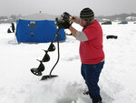 In this Feb. 23, 2019 photo, Jason Kong uses an auger to drill holes in Lake Minnetonka in Wayzata, Minn., as he prepares to go ice fishing. Since 1970, Minnesota's winters have been warming at a rate of more than 1 degree a decade. State residents notice the change, and say winter isn't as cold as it used to be and the snow is less predictable. (AP Photo/Jeff Baenen)