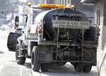 A de-icing truck filled with salt-brine fluid pulls away from a maintenance yard Thursday, Feb. 7, 2019, in Tacoma, Wash., during preparations for snow and ice expected to hit the area Friday and Saturday from an anticipated winter storm system. (AP Photo/Ted S. Warren)